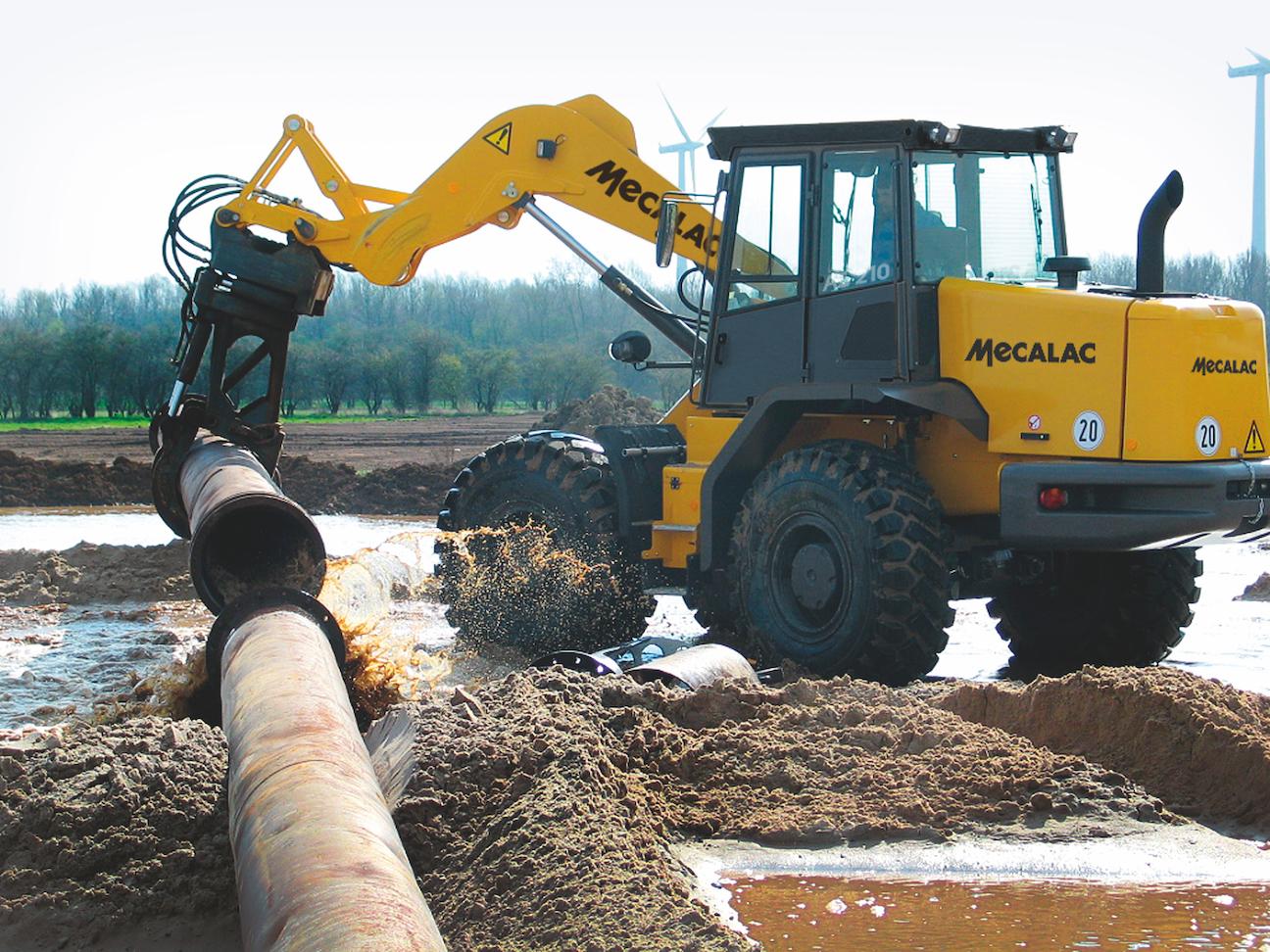 Mecalac AS210e wheel loader laying pipe